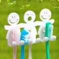 Държач за четки за зъби